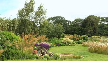 A garden woven into the Waveney landscape with a sunken sitting area at the heart of deep borders wi