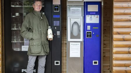 Oliver Hemsley founder of Hollis Mead by one of the organic milk vending machines Photo: BNPS
