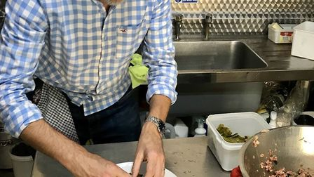 Mark Fitch making his dolmades in Andrea's kitchen. Photo: Mark Fitch
