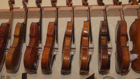 A row of instruments in Resonant Strings' workshop. Photo: Brittany Woodman