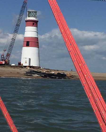 The lighthouse framed by the rigginging of Paul Botterill's boat. Photo: Paul Botterill