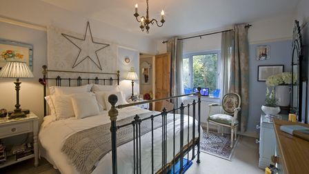 Master bedroom: Bedside tables and lamps, Laura Ashley, 01603 505041, stained glass from the Metropo