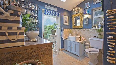 Garden bathroom: Shelving from Liberty's London, bistro table from Chelsea Antiques (photo: Tony Hal