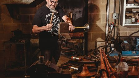 Andy Taylor hand makes trumpets for musician all over the world