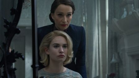 Lily James as Mrs de Winter and Kristin Scott Thomas as Mrs. Danvers in the soon to be released Net