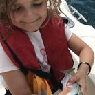My daughter Isla fishing for mackerel on my boat in Lyme Bay Photo: Mark Hix