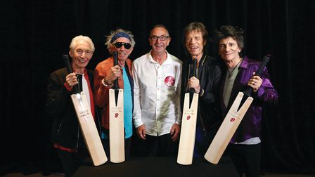 One of David's proudest moments was presenting the Rolling Stones with commemorative cricket bats ba