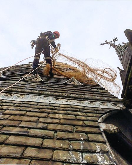Putting safety netting up on the main spire of Scarisbrick Hall School demands all the teams experti