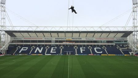 Matt Lavery and his team work on high ropes on maintenance work on the roof and floodlight towers at