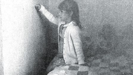 """Six-year-old Gemma Wiles points out the """"doorway"""" in her bedroom in June 1983.through which her gho"""