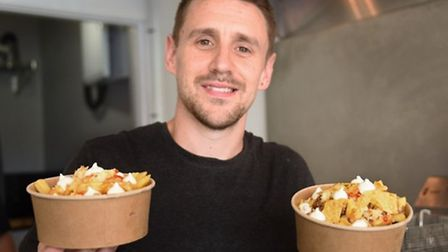 Nathan Boon, owner of Bucket List, fries in a bucket tub with toppings in the new Cromer shop. Pictu
