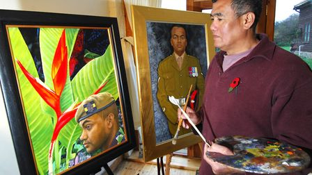 Artist Danny Keen with his paintings of Iraq war hero Johnson Beharry which was exhibited in The Imp