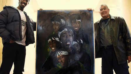 Artist Danny Keen, right, unveils his portrait of Norwich actor Roger Nsengiyumva at the City Hall a