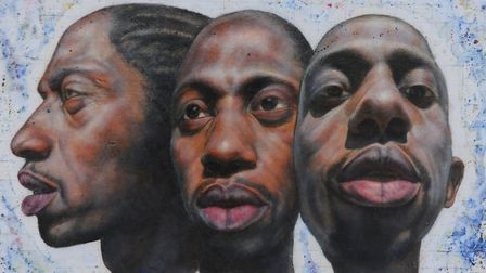 A painting by Danny Keen of scientist rapper Jonathan Chase Picture: Denise Bradley