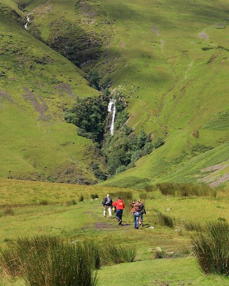 Walkers heading towards Cautley Spout PICTURE CREDIT: VIVIENNE CROW