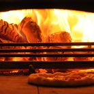 A pizza nestles in the wood-fired oven at Eric's Pizza at Drove Orchards, near Hunstanton Picture: