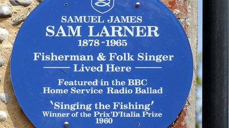 The blue plaque in honour of the famous Norfolk folk singer and fisherman Sam Larner who lived in Bu