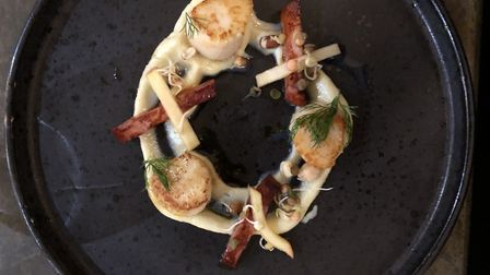 The starter of scallops with cauliflower puree, smoked chorizo and pickled apple Photo: Steve Harris