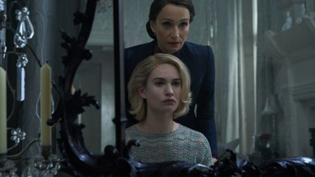 Kristin Scott Thomas as Mrs Danvers with Lily James as the new Mrs de Winter Photo: Kerry Brown/Netf