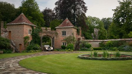Max drives through the entrance gates of Manderley with his new bride - Cranborne Manor provided the