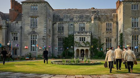 Dorset summer evening sunshine bathes the entrance to Cranborne Manor for the filming of the grand b