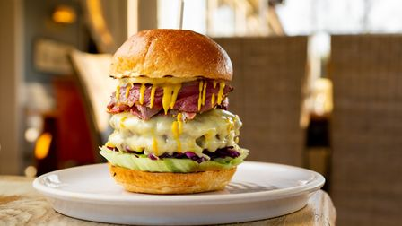 From the menu at The Dukes Head, Somerleyton, the Dukes burger is fully loaded, two patties layered
