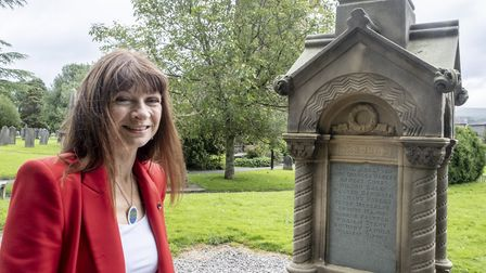 Kirkby Lonsdale Churchyard tour feature. Guide Tess Pyke in St Mary's Church yard in Kirkby Lonsdale