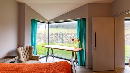 Ground floor bedrooms are simple and flooded with light