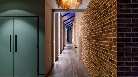 Brick walls feature inslide the building to link it to the outside
