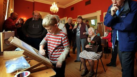Totally engrossed, eight-year-old Keiron Williamson painting at the Swaffham Art Festival Photo: Bil