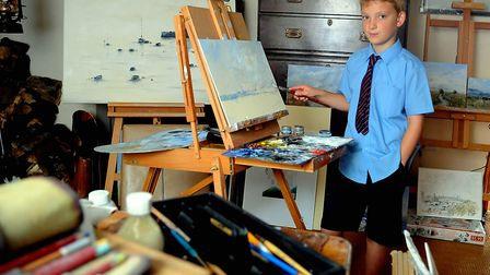 Artist Keiron Williamson, 9, in his studio at his home at Ludham getting ready for his forthcoming e