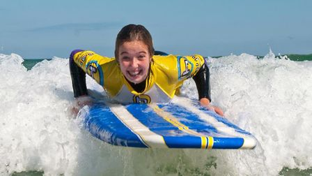 Beginner surfer at Harlyn Bay