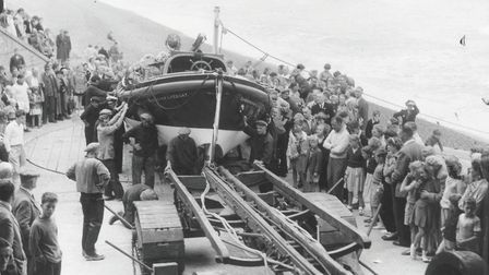 Holidaymakers crowd round as Sheringham lifeboat comes back after its Lifeboat Day launch on 11 Augu