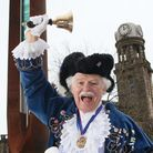 Nelson Town Cryer, Tony Beckett reads the Lancashire Day proclamation by the Shuttle Monument near t