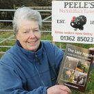 Patricia Graham with the book she wrote about her family and Norfolk black turkeys. Picture: Ian Bu