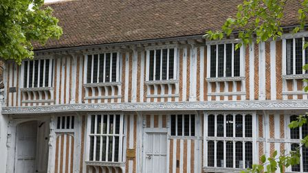 A close view of the windows and the plasterwork on the exterior of Paycocke's House, Coggeshall