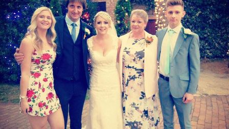 Steve Fulcher (second left) pictured with his three children Paige, Holly and Christopher and wife Dawn at Holly's wedding.