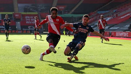Southampton's Kyle Walker-Peters and Arsenal's Cedric Soares battle for the ball