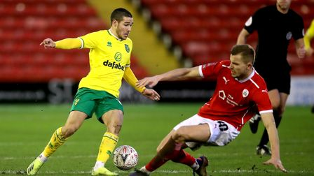 Norwich City's Emi Buendia (left) and Barnsley's Michal Helik battle for the ball during the Emirate