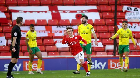 Barnsley's Callum Styles (centre) celebrates scoring his side's first goal of the game during the Em