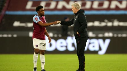 West Ham United manager David Moyes and Oladapo Afolayan (left) celebrate victory with a fist bump a