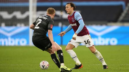 West Ham United's Mark Noble (right) and Doncaster Rovers' Bradley Halliday (left) battle for the ba