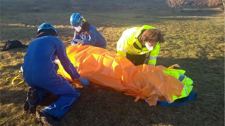 Rescue teams treat injured woman
