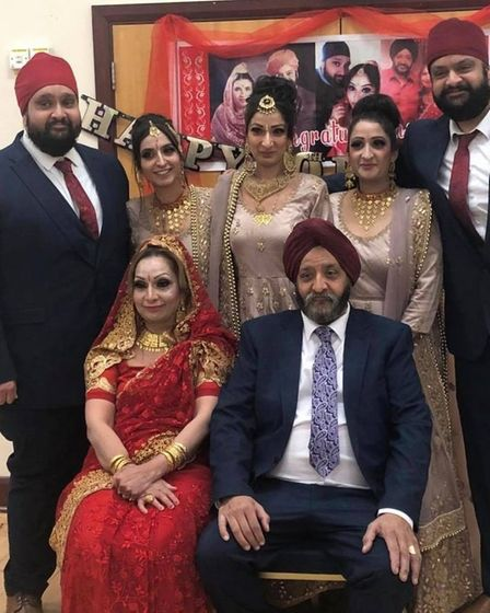Mr Singh surrounded by his family