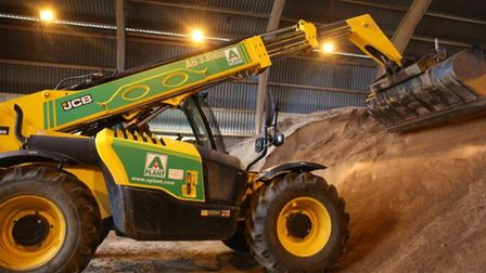 A digger picks up some salt ready to load onto a gritting truck at the Coreys Mill depot in Stevenage