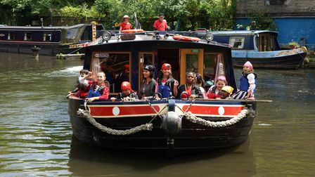 Children aboard one of The Pirate Castle boats on the Regent's Canal