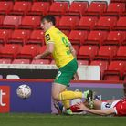 Jordan Hugill of Norwich and Michal Helik of Barnsley in action during the FA Cup match at Oakwell,