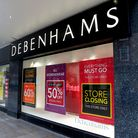 Closing down signs in the window of Debenhams in Worcester. Prime Minister Boris Johnson ordered a n