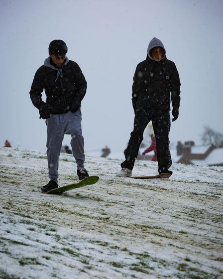snowboarders england snow down hill