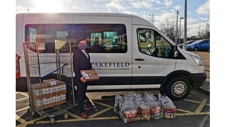 Acting head of school at Pakefield High School, Dan Bagshaw,arranging the delivery of laptops and food parcels to supportfamilies.